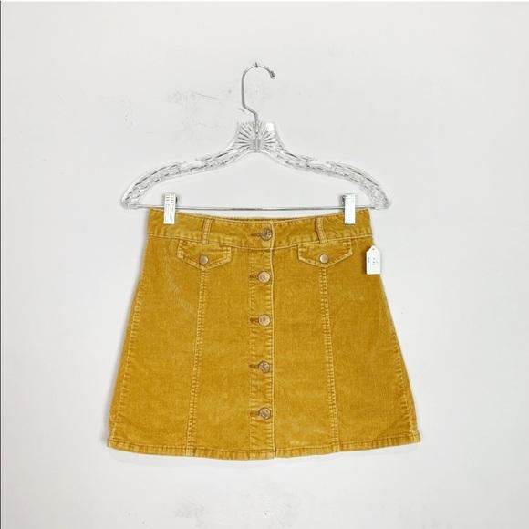 81dc67007 BDG Mustard yellow corduroy a-line button up skirt.  M_5cb9470bd948a14276f6892b
